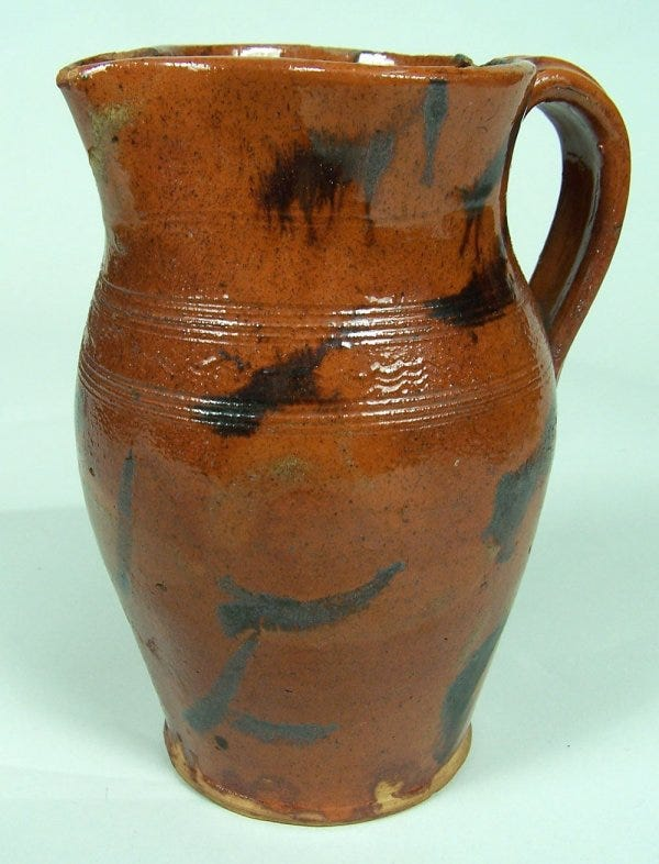 Lot 101: An exceptional East Tennessee redware pitcher, attributed to Cain pottery
