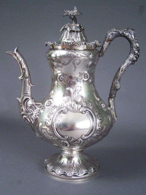 Lot 103: Rare Tennessee coin silver coffee pot, marked W. H. Calhoun  Tenn.