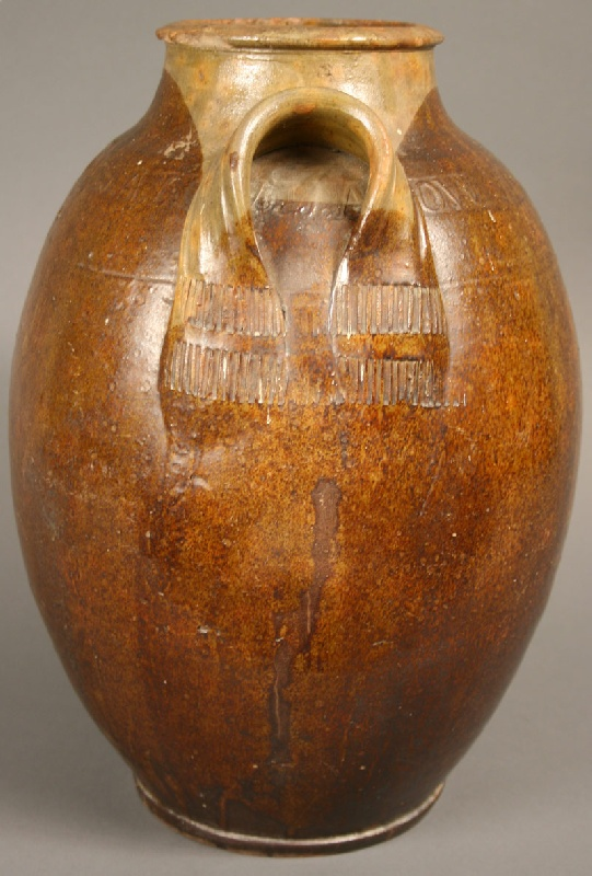 Lot 64: Exceptional and rare Greene County, TN redware jar, marked,  J.A. Lowe