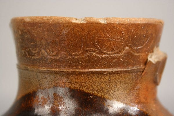 Lot 78: Greene Co., Tennessee redware pitcher, stamped C.A. Haun