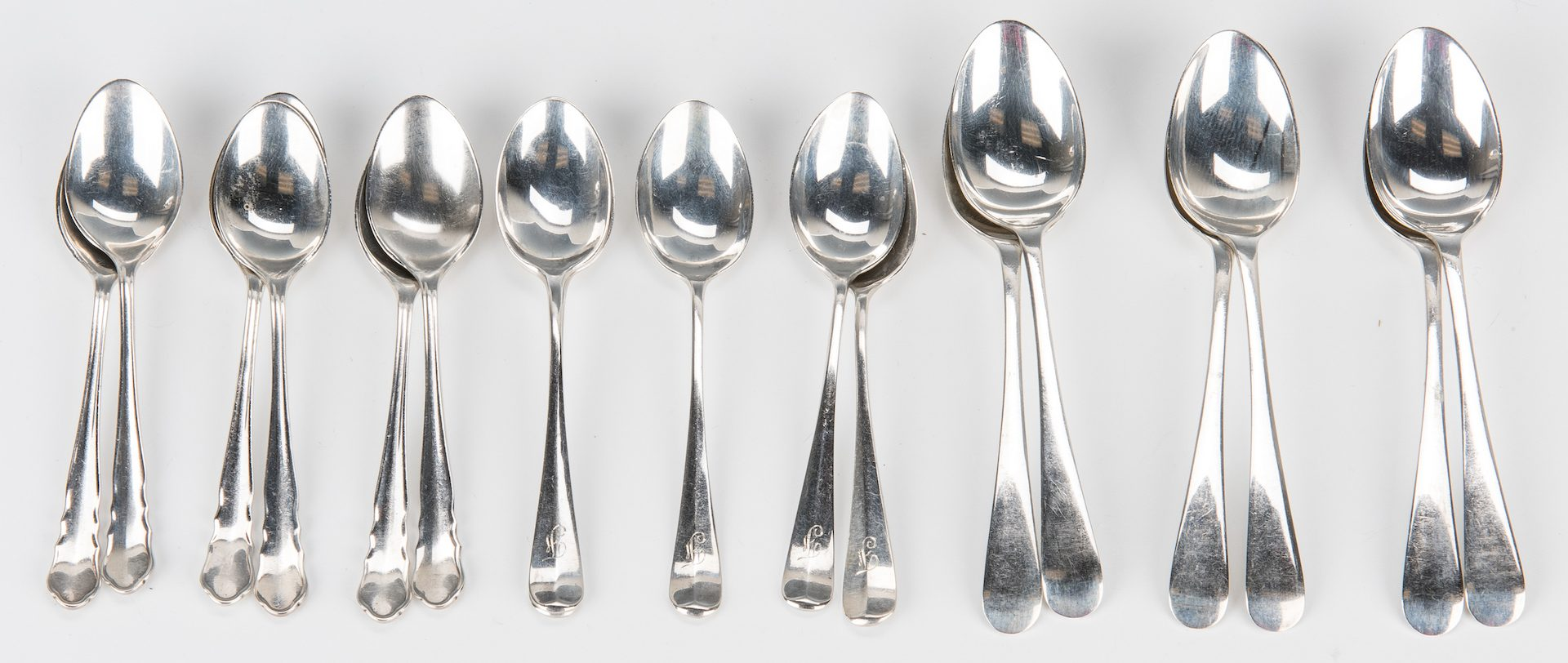 Lot 860: English Sterling Caster, Tongs, Spoons, 20 Pcs.