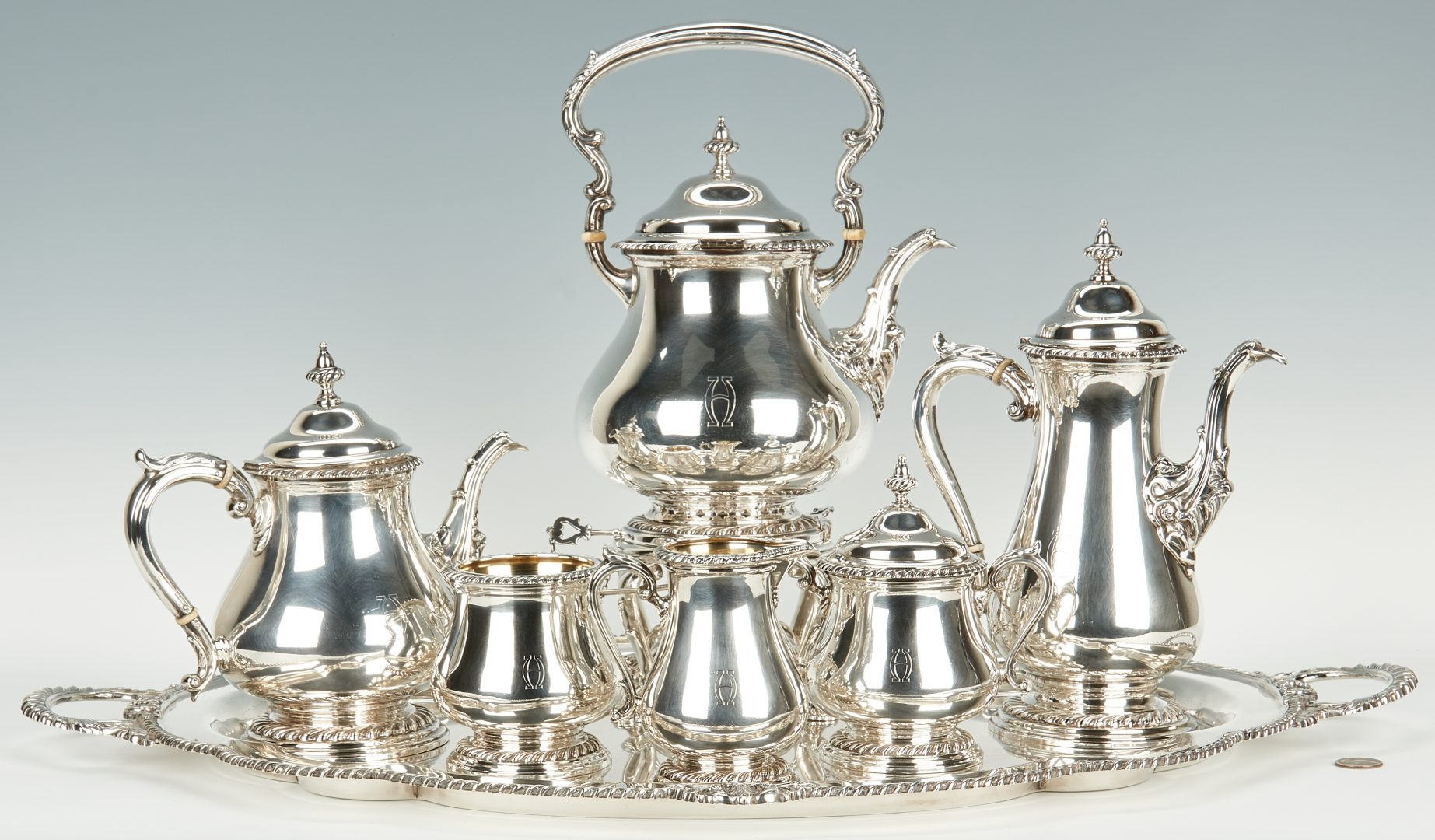 Sterling silver tea service with retailer marks for Shreve & Company