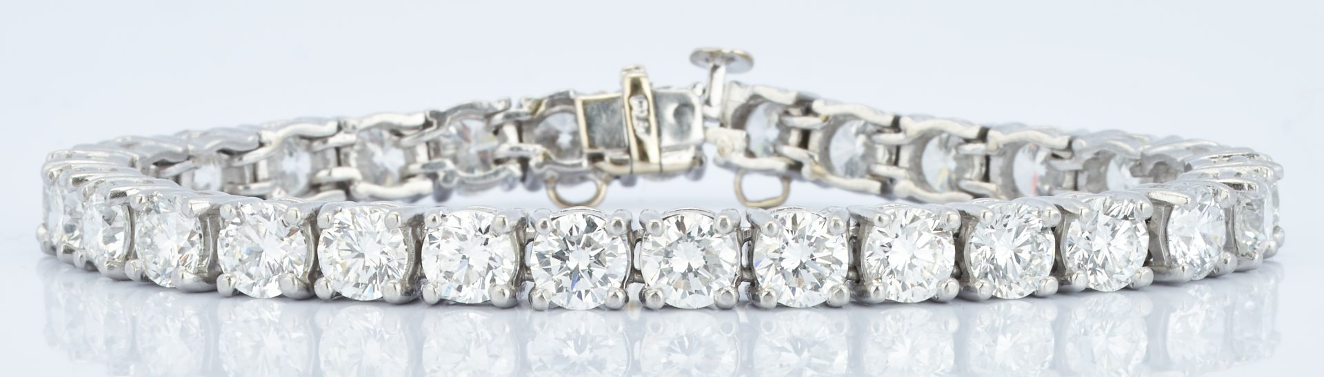 Lady's platinum tennis style line bracelet with 29 round brilliant diamonds approx. 13ctw.