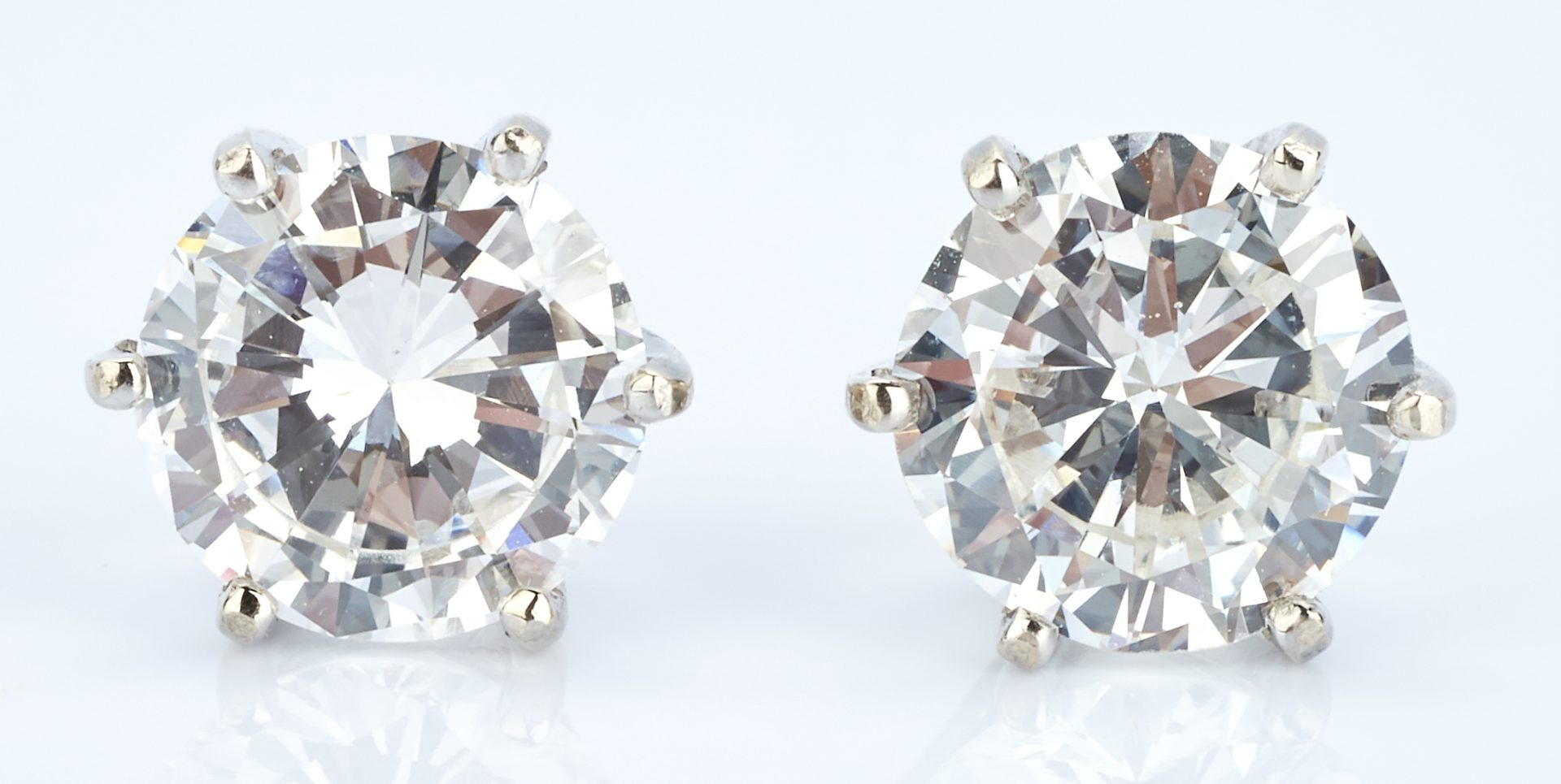 Pair of stud earrings with 2 diamonds, approx. 2ctw.