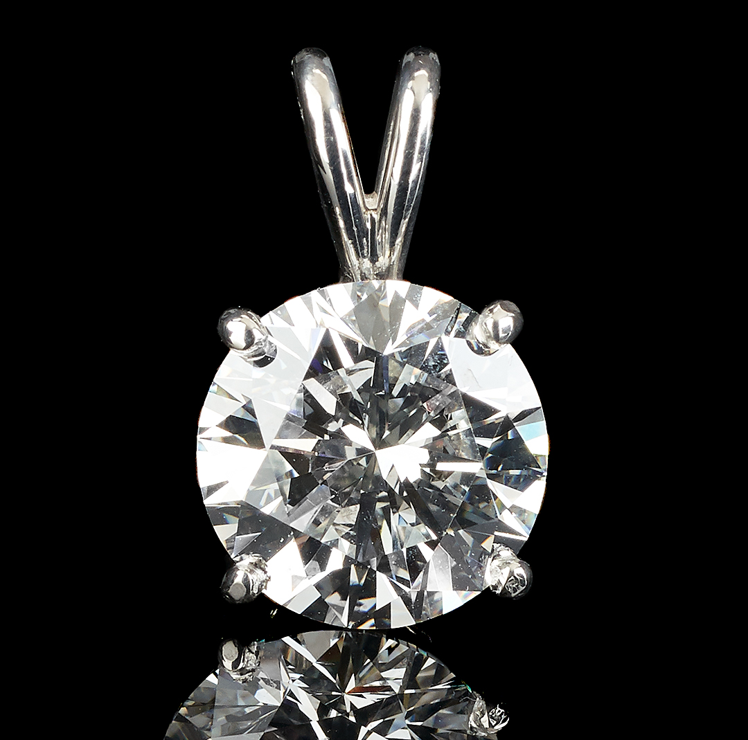 Lot 30: 4.18 CTW Diamond Pendant, GIA (VVS2, E)